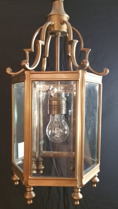 old brass and bevelled glass lantern
